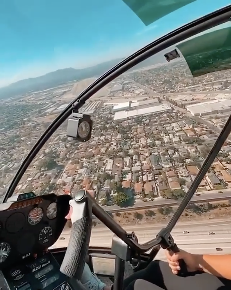 Helicopter pilot flying over city