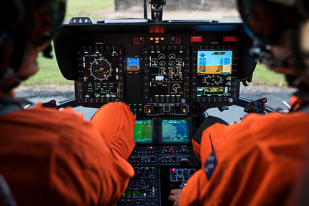Airbus helicopter cockpit with pilots